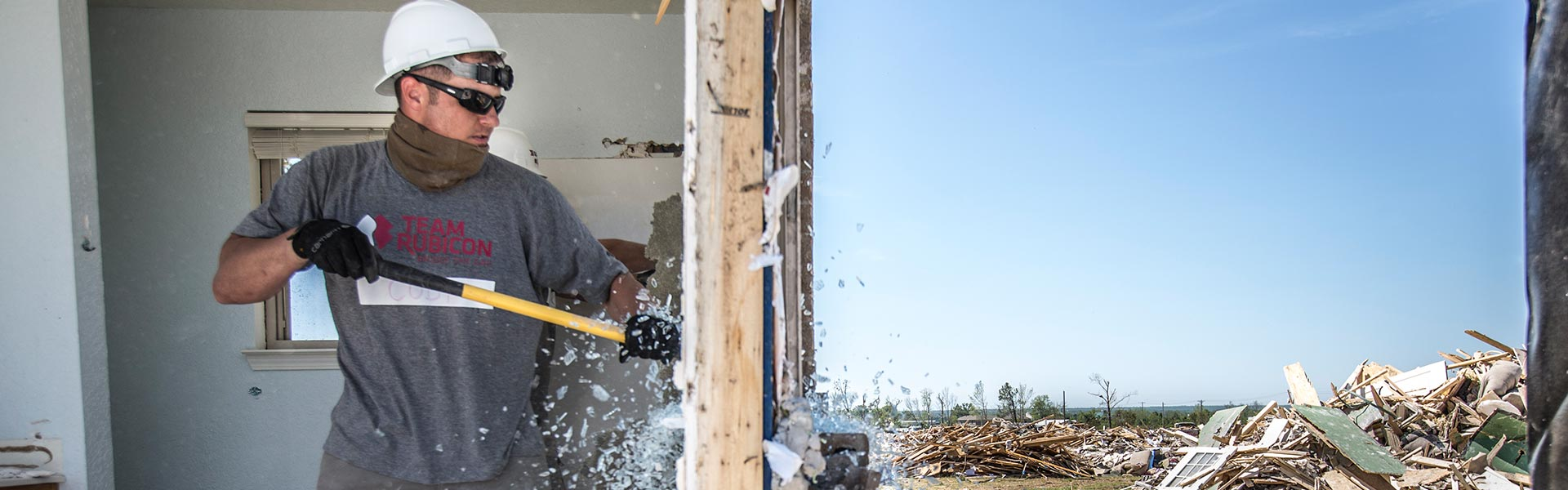 Team Rubicon volunteer demolishes the remnants of a home after a devastating tornado.
